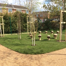 Silver Birch and wooden mushrooms create a lovely sheltered area for storytime and lessons